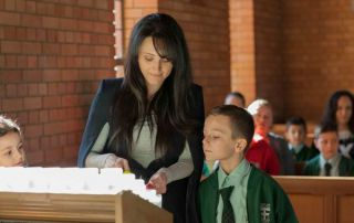 St Francis Xavier Catholic Primary School Ashbury - Parent and student lighting candles