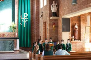 St Francis Xavier Catholic Primary School Ashbury - students reading the bible inside a church