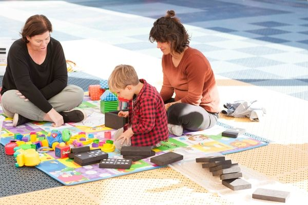 St Francis Xavier Catholic Primary School Ashbury - teacher, parent and student playing with giant dominoes at school