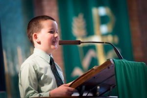 St Francis Xavier Catholic Primary School Ashbury - student talking in front of school assembly