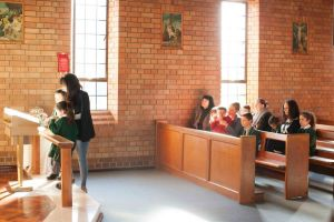 St Francis Xavier Catholic Primary School Ashbury - parents and children at mass